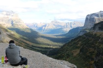 Adam soaking in the view while enjoying a well deserved snack after our hike at Logan Pass.