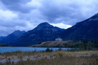 Prince of Wales Hotel lit up at night in Waterton Lakes National Park.
