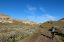 Amanda biking in the badlands in Dinosaur Provincial Park.