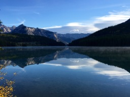 Beautiful reflection with som morning mist on Two Jack Lake in Banff National Park.