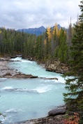 Beautiful rapids of the Kicking Horse River flowing under the natural bridge in Yoho National Park, BC.