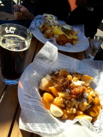 Our tasty feast of fish and chips and perogie poutine at Grizzly Paw Brewing Company in Canmore.