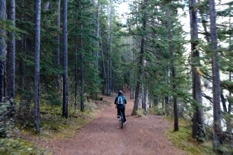 Amanda riding a trail along Lake Minnewanka in Banff National Park.