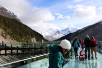 Amanda enjoying the views on the Glacier Skywalk looking through the glass-floor platform.