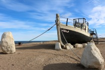 The Enterprise - a herring seiner brought over from Scotland in 1976 - along the shoreline of Hudson Bay at Munck Park, Churchill, Manitoba