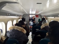 Fellow ski plane passengers all packed in tightly