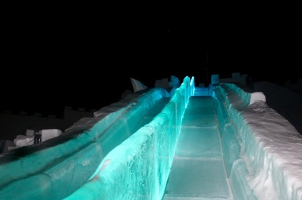 The ice slide lit up at the Snowking Castle for the Royal Ball