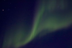 Our first Yellowknife glimpse of the Northern Lights from our cabin's front porch!