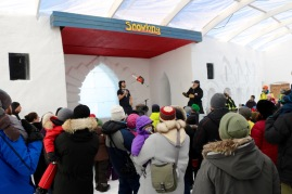 Eric the Juggler juggles a chainsaw on stage at the snowcastle