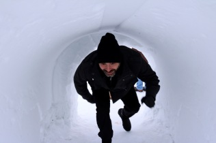 Bryan going through the tunnel under the ice slides at the Snowking Castle