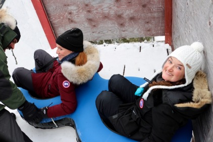 Nicole and Amanda ready to launch down the snow tube slide at Aurora Village