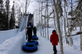 Running up the snow tube slide at Aurora Village