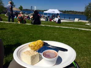 Enjoying the delicious fresh fish, corn, bannock and beans at Somba Ke Plaza for Aboriginal Day.