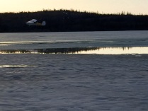 We stopped at a dock on Back Bay to watch the float/ski planes practice taking off from the melting ice