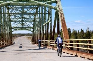 Team LCP Health cruising over the Frank Channel bridge (near Behchoko)
